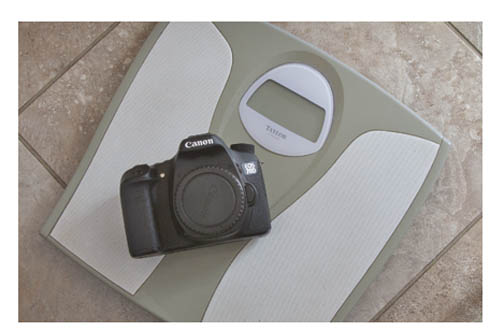 Photo of Canon EOS 70D on a bathroom scale
