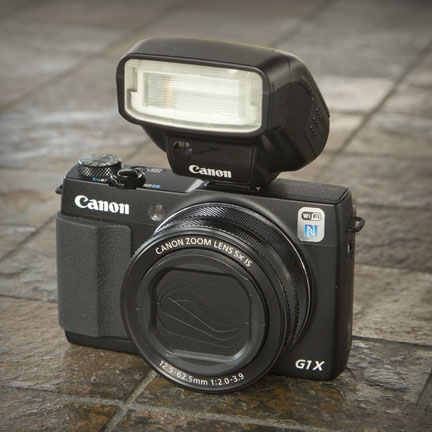Powershot G1X Mark II With 270EX II attached to hot shoe