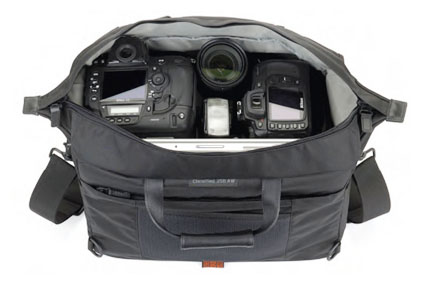 You can fit two t3i camera bodies in this bag from Lowepro