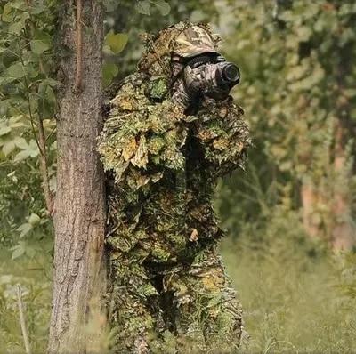 camouflaged photographer