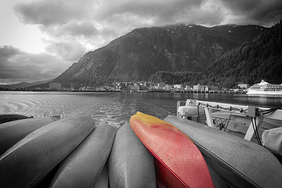 monochrome photo of kayaks