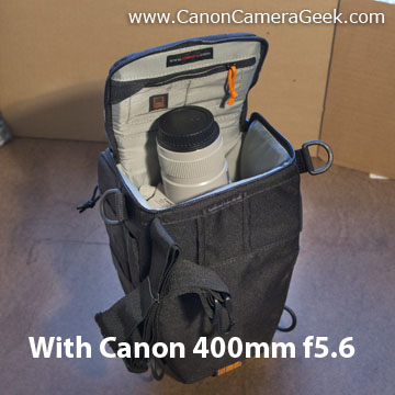 Top loading Lowepro 55 AW camera bag with Canon 400mm f5.6 lens inserted.