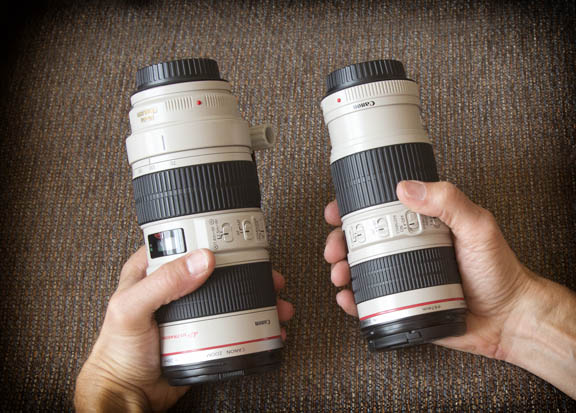 Hands holding the 70-200mm lenses