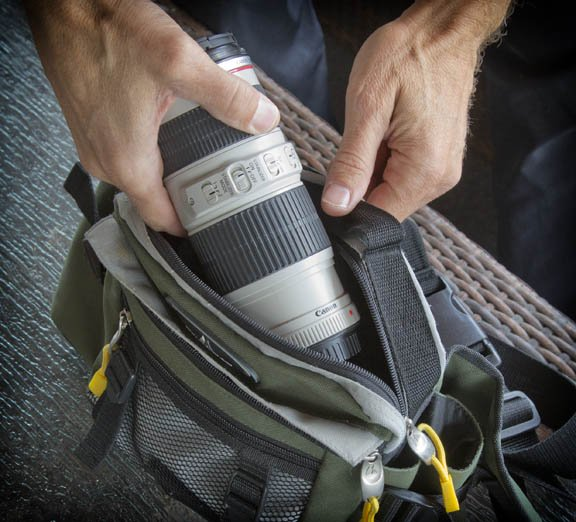 Canon 70-22mm f/4 fits easily in my small waiste-level, beltpack,